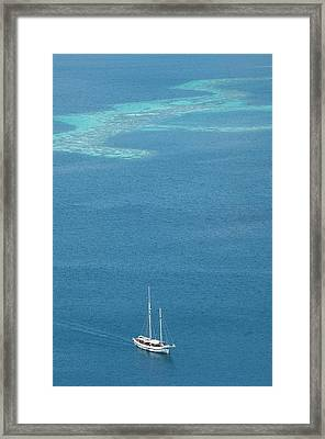 Yacht With Coral Reef Behind Framed Print by Scubazoo