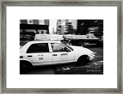 Yellow Cab With Advertising Hoarding Blurring Past Crosswalk And Pedestrians New York City Usa Framed Print by Joe Fox
