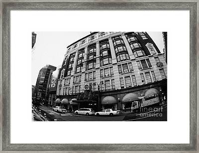 yellow cabs wait outside Macys at Broadway and 34th Street Herald Square new york Framed Print by Joe Fox