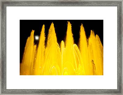 Yellow Fountain At Night Framed Print by Raimond Klavins