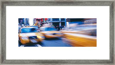 Yellow Taxis On The Road, Times Square Framed Print by Panoramic Images
