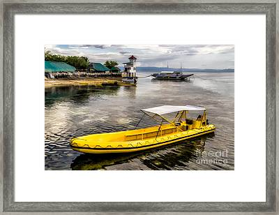 Yellow Tour Boat Framed Print by Adrian Evans
