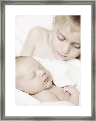 Young Boy Holding Baby Framed Print by Don Hammond