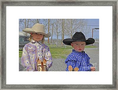 Young Cowboy And Cowgirl Stick Ponies Framed Print by Valerie Garner