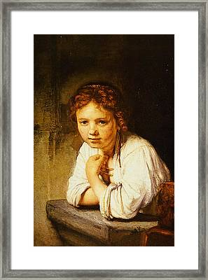 Young Girl At A Window Framed Print by Rembrandt