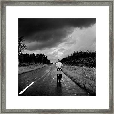 Young Man On The Road Framed Print by Donald  Erickson