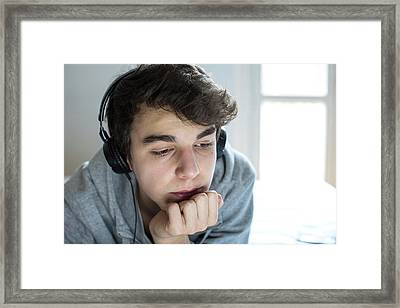 Young Man Wearing Headphones Framed Print by Mauro Fermariello