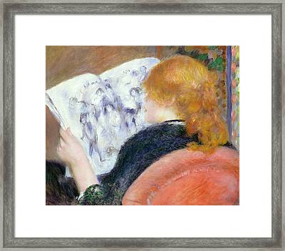 Young Woman Reading An Illustrated Journal Framed Print by Pierre Auguste Renoir