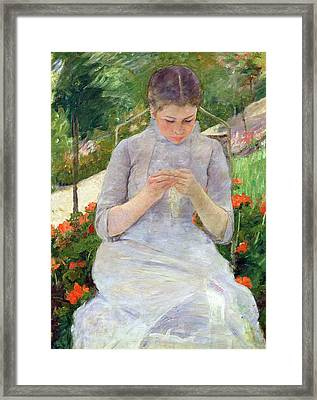 Young Woman Sewing In The Garden Framed Print by Mary Stevenson Cassatt