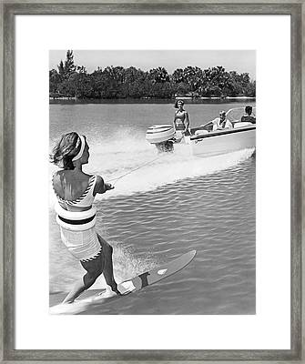 Young Woman Slalom Water Skis Framed Print by Underwood Archives