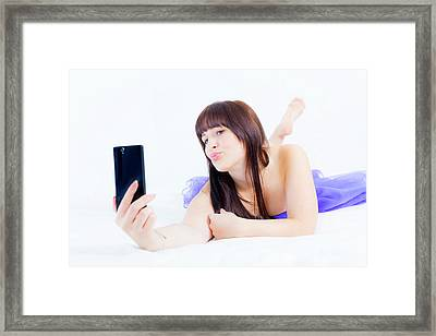 Young Woman Using Smartphone Framed Print by Wladimir Bulgar