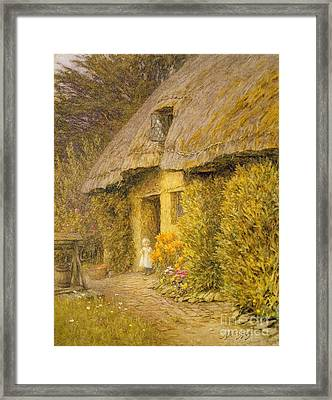 A Child At The Doorway Of A Thatched Cottage  Framed Print by Helen Allingham