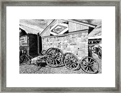 Antique Wagon Wheels Framed Print by James Steele