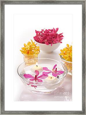 Orchid Head And Candle  Framed Print by Atiketta Sangasaeng