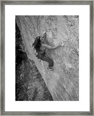 A Caucasian Women Rock Climbing Framed Print by Bobby Model