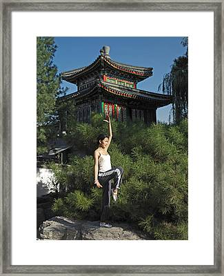 A Chinese Woman In Her 20s To 30s Doing Framed Print by Justin Guariglia