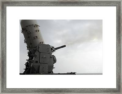 A Close-in Weapons System Is Fired Framed Print by Stocktrek Images