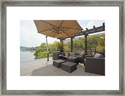 A House Terrace Overlooking The Water Framed Print by Marlene Ford