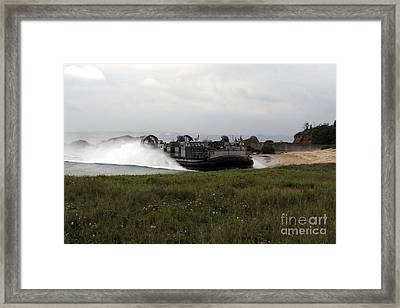 A Landing Craft Air Cushion Comes Framed Print by Stocktrek Images