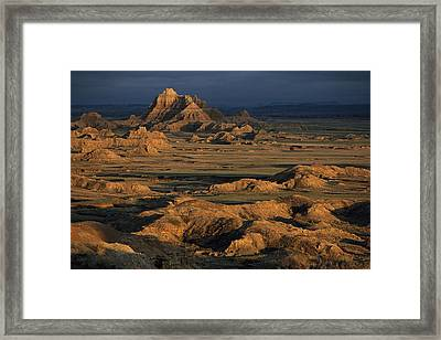 A Landscape Of Isolated Buttes And Rock Framed Print by Annie Griffiths