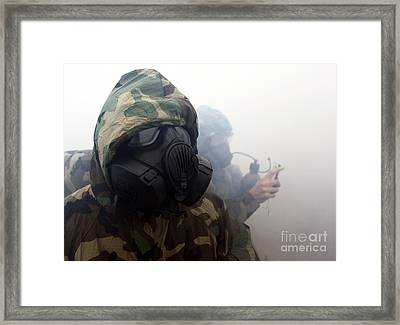 A Marine Wearing A Gas Mask Framed Print by Stocktrek Images