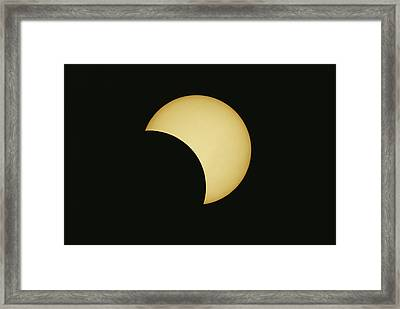 A Solar Eclipse Takes Place In France Framed Print by Carsten Peter
