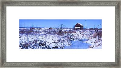 Abandoned Shack Near Frozen Creek In Framed Print by Corey Hochachka