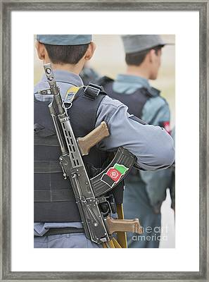 An Ak-47 Rests On The Sling Of An Framed Print by Terry Moore
