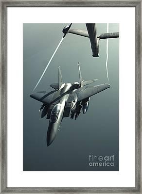 An F-15e Strike Eagle Flies Over Iraq Framed Print by Stocktrek Images