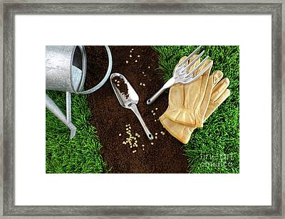 Assortment Of Garden Tools On Earth Framed Print by Sandra Cunningham
