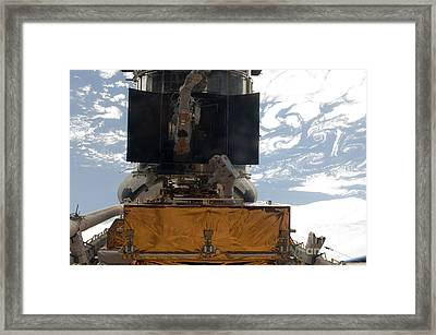 Astronauts Working On The Hubble Space Framed Print by Stocktrek Images