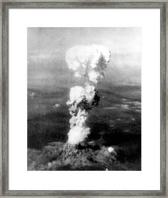 Atomic Bomb. A Mushroom Cloud Rises Framed Print by Everett