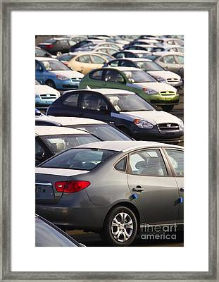 Automobiles In A Parking Lot Framed Print by David Buffington