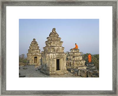 Buddhist Monks Amongst Temple Ruins Framed Print by Martin Puddy