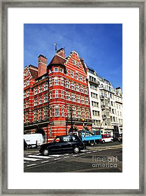Busy Street Corner In London Framed Print by Elena Elisseeva