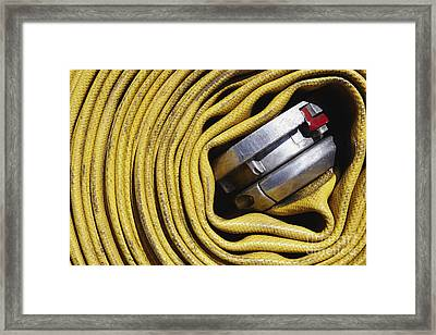 Coiled Fire Hose Framed Print by Skip Nall