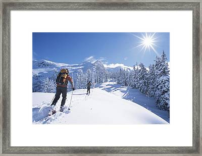 Cross-country Skiers In The Selkirk Framed Print by Jimmy Chin