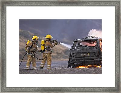 Firefighters Hosing A Burning Car Framed Print by Duncan Shaw