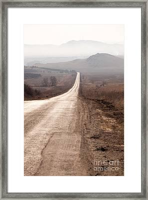 Foggy Road In Dobrogea Framed Print by Gabriela Insuratelu