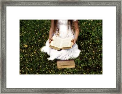 Girl Is Reading A Book Framed Print by Joana Kruse