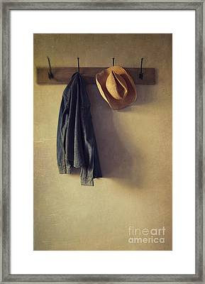 Jean Shirt And Straw Hat Hanging On Hooks Framed Print by Sandra Cunningham