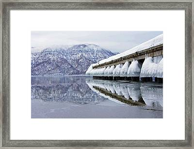 Lake Towada In Winter Framed Print by The landscape of regional cities in Japan.