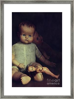 Old Dolls Sitting On Wooden Table Framed Print by Sandra Cunningham