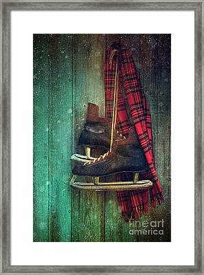 Old Ice Skates Hanging On Barn Wall Framed Print by Sandra Cunningham