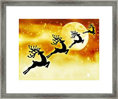 Reindeer Silhouette In Night Sky Framed Print by Anna Omelchenko