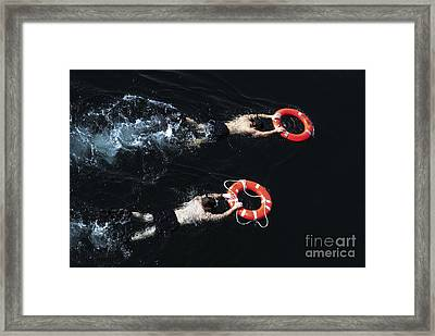 Search And Rescue Swimmers Framed Print by Stocktrek Images