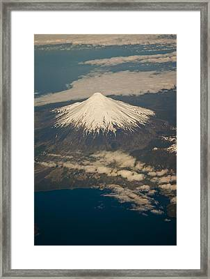 Snowcovered Volcano Andes Chile Framed Print by Colin Monteath