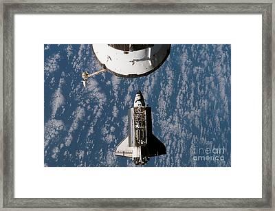 Space Shuttle Atlantis Approaching Framed Print by Stocktrek Images