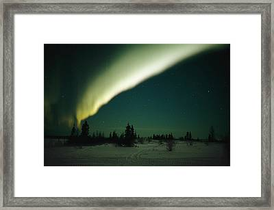The Aurora Borealis Glows Brightly Framed Print by Norbert Rosing