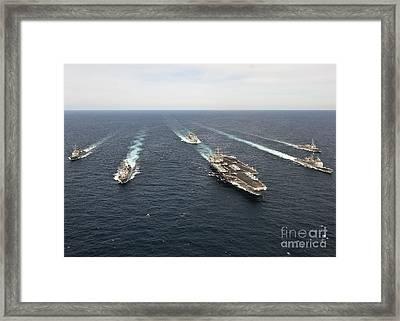 The Enterprise Carrier Strike Group Framed Print by Stocktrek Images